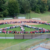 "J.S.CARRAS/THE RECORD Five hundred thirteen students grades three thru five form human peace sign for ""Peace Week"" Friday, September 27, 2013 at Rensselaer Park Elementary School in Lansingburgh, N.Y.."