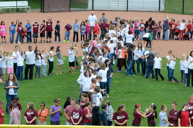 """J.S.CARRAS/THE RECORD Five hundred thirteen students grades three thru five form human peace sign for """"Peace Week"""" Friday, September 27, 2013 at Rensselaer Park Elementary School in Lansingburgh, N.Y.."""