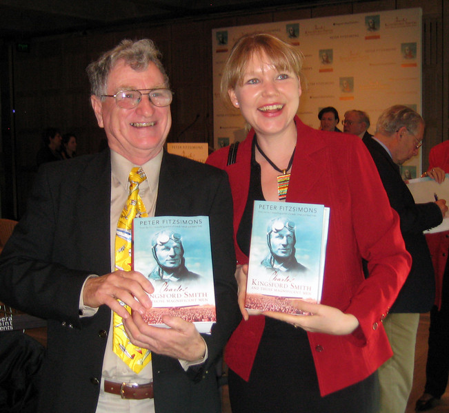 Peter with fellow researcher, Sonja Goernitz, with their copies of Peter FitzSimons' book, Charles Kingsford Smith and Those Magnificent Men at the official launch in the Utzon Room of the Sydney Opera House, June 11, 2009. John Ulm signs a book behind.