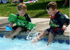 Jack Josefowski, age 2 and Joe Aylmer, age 3 are  having fun splashing as they kick their feet. Photo by Anne Neborak Delco News Network