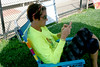 Tyl Sadoff sits at the pool but  still is working at her job answering e-mails. Photo by Anne Neborak Delco News Network