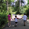 Kendra Enos, Riley Roper, and Ben Enos walking on Cummings Center Trail in Beverly.