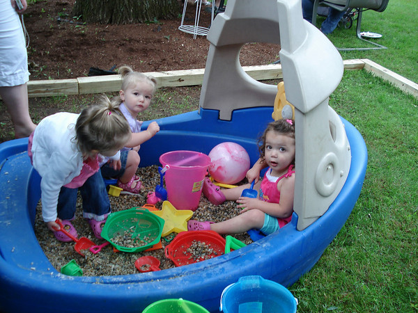 Taryn, Chloe and Rylie Hegarty, three cousins, at Rylie's birthday party, enjoying the sandbox. Their grandmother, and the photographer, is Salem native Fran Centorino Hegarty.