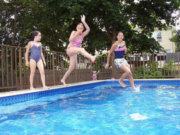 Kylie Gale, Rebecca Beaulieu, and Caylee Post, cousins, enjoying summer fun at the pool.