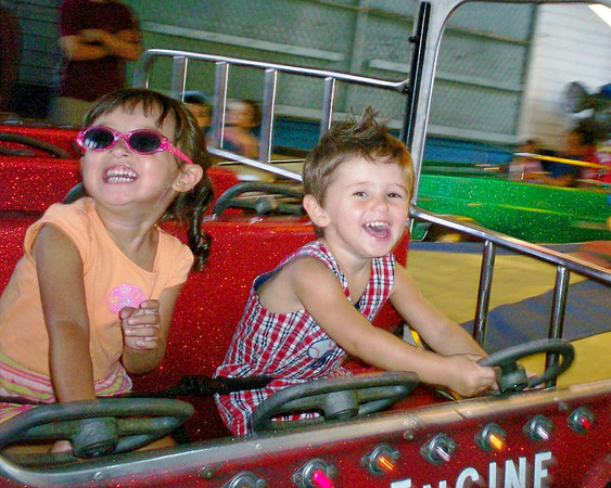 Emma Grace Cunningham, left, taking her first ride of the summer at Salem Willows.