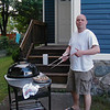 Michael Falchek grilling in the yard in Salem.