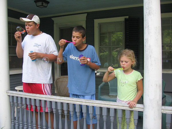 Tyler, James and Kirsten Loring at grandmother Phyllis Ballou's house in Salem, blowing bubbles.