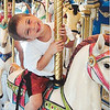 Christopher Pietrini, age 4, of Beverly, enjoys a carousel ride at Canobie Lake Park.<br /> <br />  <br /> Original: Christopher Pietrini, age 4, of Beverly<br /> <br /> processed by IntelliTune on 04022009   105532<br /> with script Lawrence RGB to CMYK and Move