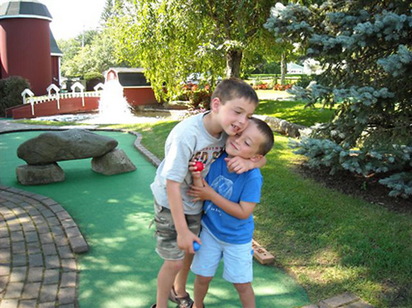 Brothers Jameson and Finnegan Manning of Byfield at the 18th hole at Richardson's in Middleton.