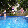 Kylie Gale, Rebecca Beaulieu, and Caylee Post of Salem,  cousins, enjoying summer fun at the pool.