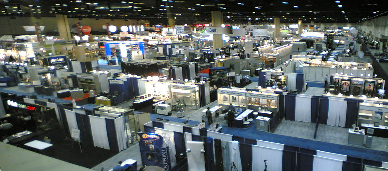 Here's a view of the entire show floor. <br /> 1/2 the size of last year.<br /> The Adobe booth is way down that first isle.
