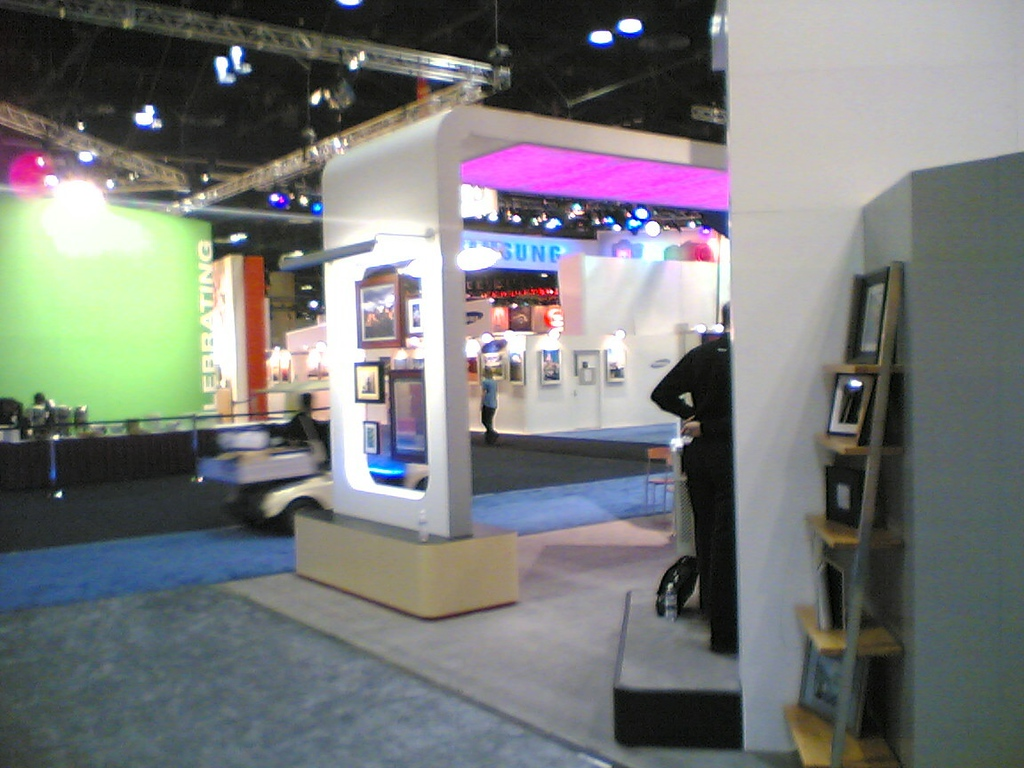 Around both sides of the booth was a shelf, displaying various APS products.