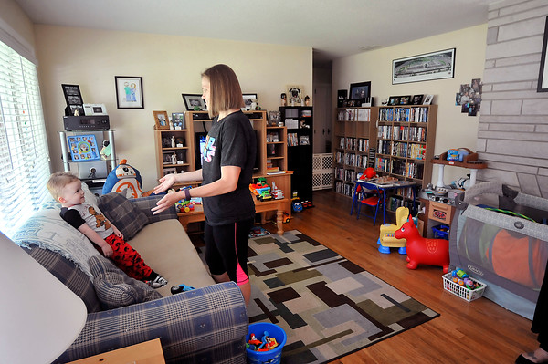 John P. Cleary | The Herald Bulletin<br /> Lindsey Dollar gets her 2 year old son Galen to put him down for his afternoon nap.
