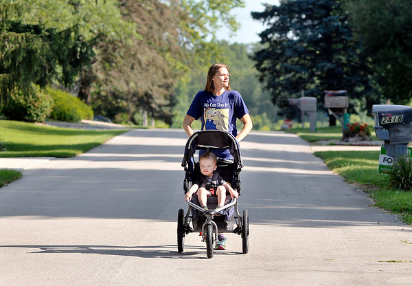John P. Cleary   The Herald Bulletin<br /> Lindsey Dollar, with 2 year old son Galen in the stroller, go around the neighborhood for their morning walk, or jog, everyday.