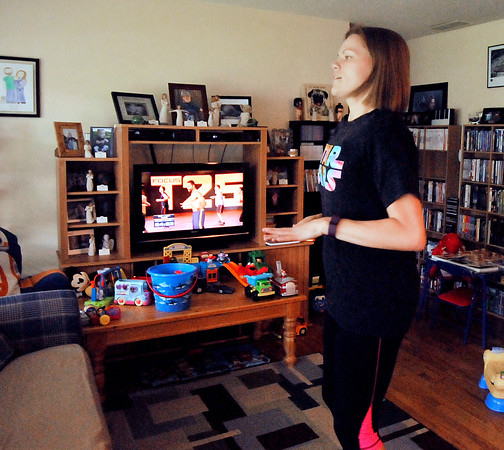 John P. Cleary   The Herald Bulletin<br /> Lindsey Dollar does her daily T25 video workout while her son Galen is napping.