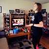 John P. Cleary | The Herald Bulletin<br /> Lindsey Dollar does her daily T25 video workout while her son Galen is napping.