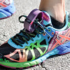 John P. Cleary | The Herald Bulletin<br /> Lindsey Dollar ties her pedometer to her shoe when she goes for her walks, or jogs, with son Galen to get a reading while pushing the stroller.