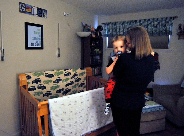 John P. Cleary | The Herald Bulletin<br /> Lindsey Dollar puts her son Galen down for his afternoon nap.