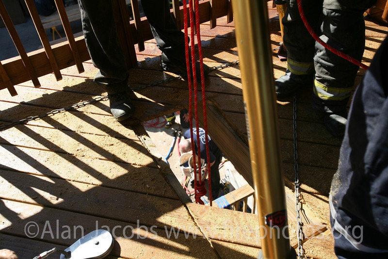 Lines attached to a tripod and pulley dropped three stories and more into the pit to secure both victims and rescuers.