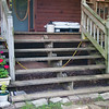 This is what it looked like before. Originally we had logs for steps, but they rotted so I went to 2 X 10's. Now the supporting members are starting to fail and the nails have rusted and broken. Time to rebuild.