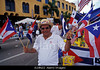 NEW M014, Fig 1.14 Choice 6 of 9<br /> <br /> A18N22 HISPANIC MALE WITH SUNGLASSES WAVING PUERTO RICAN FLAGS AT ANNUAL CALLE OCHO CARNAVALE, LITTLE HAVANA, MIAMI, FLORIDA