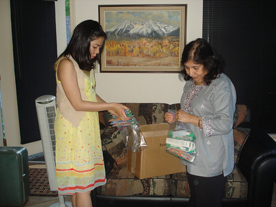 Packing Suitcases with Dental Supplies and Children's clothes for UMM