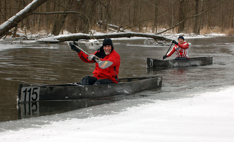 Bill Schmitz of Commerce Township, left, and Dan Klinkhammer of Northville maneuver their C-1 racing canoes around the ice on the Huron River, just downstream from the Island Lake Recreation Area near Brighton on Sunday, Feb. 4, 2007.  The high temperature for Sunday was in the single digits, with wind- chill temps well below zero.  (MARK BIALEK/Special to the Detroit News)