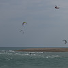 Coming back for another look through the kite surfers
