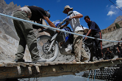 James' bike crosses the bridge having safely negotiated the slope.