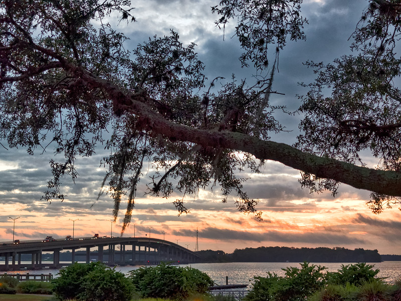 Palatka Riverfront Park and Memorial Bridge across the St. Johns River in Palatka, Florida, at sunrise.
