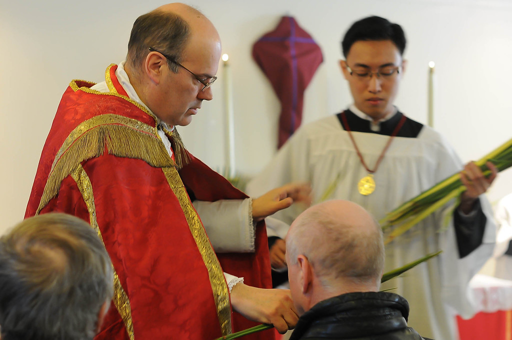 The Catholic Church considers the blessed palms to be sacramentals. The vestments for the day are deep scarlet red, the color of blood, indicating the supreme redemptive sacrifice Christ was entering the city to fulfill: his Passion and Resurrection in Je