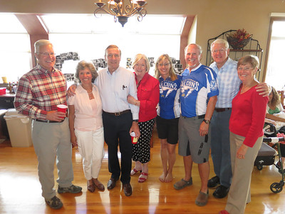 USAFA Class of '66. .. It's clear which pair are the diehard Falcon fans!