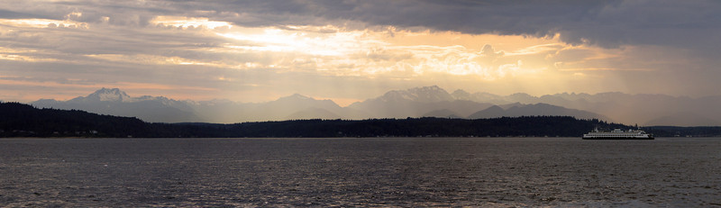 Sunset over the Olympic Mountains from Alki Beach, Seattle, WA