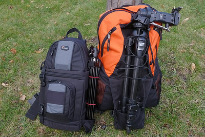 Total packed weight comparison: Panasonic MFT in black bag - 6.4 lbs.  Nikon full frame in orange bag - 21.4 lbs.