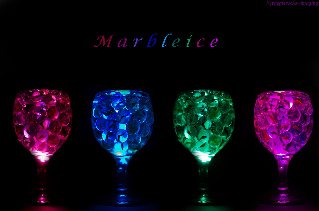 Marbleice<br /> <br /> Marbles in a glass of water with a multi-coloured light stick placed at the back of the glass.  Combined 4 images in PS.