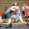 Don Knight / The Herald Bulletin<br /> Elwood's Derek Bryant wrestles Pendleton Heights' Chase Cochran in the 160 pound championship match during the Madison County Wrestling Tournament at Anderson on Saturday.
