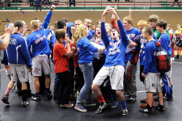 Don Knight / The Herald Bulletin<br /> Elwood celebrates after it was announced that the Panthers had won the Madison County Wrestling Tournament at Anderson on Saturday.