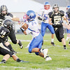 Don Knight/The Herald Bulletin<br /> Elwood's Sammy Mireless weaves through the Madison-Grant defense on Friday.