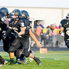 Don Knight/The Herald Bulletin<br /> Madison-Grant running back Cameron Myers gets the ball as the Argylls  hosted Elwood on Friday.