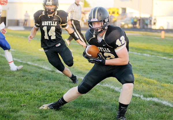 Don Knight/The Herald Bulletin<br /> Madison-Grant hosted Elwood on Friday.