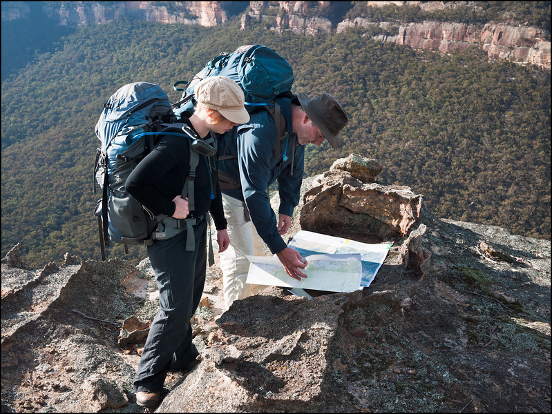 Paul and Lise check the map on Baal Bone Plateau