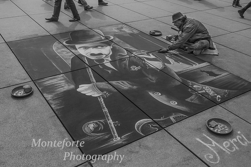 sidewalk artist near Pompiudou Center, Paris France