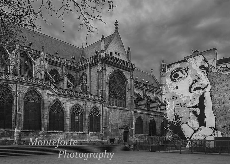 Church and art work near the Pompidou Center, Paris France
