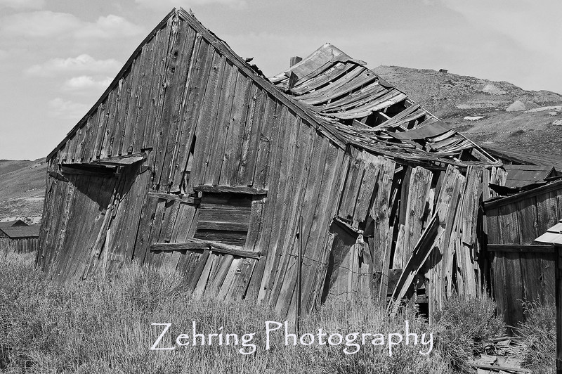 "Barely able to stand under the wieght of time and the elements, the silent groans of this strange ""ghost town"" surround the visitors of Bodie, CA."