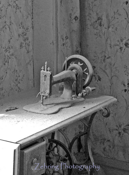 A vintage sewing machine, silent reminder of the domestic life that once was a part of this mysteriously abandoned town of Bodie, CA.