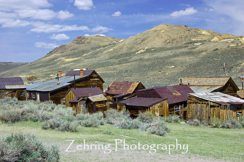 "Cluster of abandoned homes and workshops in the ""ghost town"" of Bodie, CA."