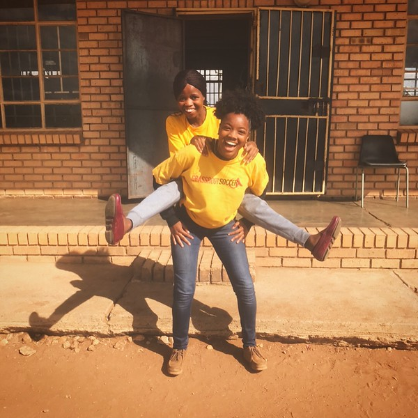 PC South Africa VOlunteer Shekinah with Counterpart Kate implement a PC SKILLZ intervention.