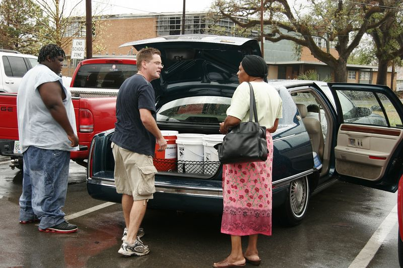 Craig helps deliver the first of the flood buckets to those who need them.