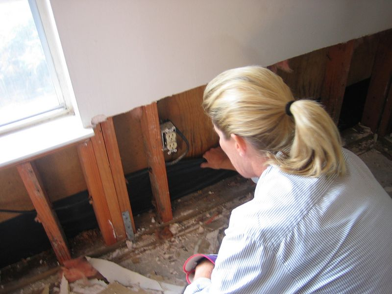 Susie Rush checks for water damage.