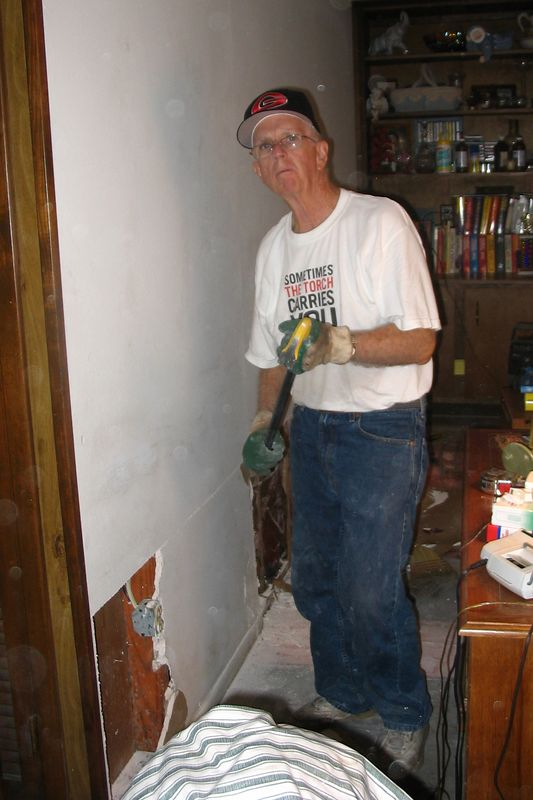 "Tommy Cullens removing ""wetwall"" from Bob and Evelyn Noonan's home in Pascagoula."